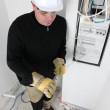 Electrician working on the fuse box — Stock Photo