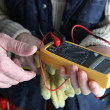 Apprentice using multimeter — Stock Photo #18443621