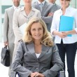 Businesswoman in a wheelchair with her colleagues — Stock Photo #18444085