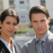 Foto Stock: Business couple standing outside