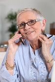 Senior woman talking on the cell — Stock Photo