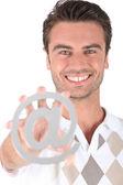 Man holding at symbol — Stok fotoğraf