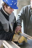 Apprentice learning how to cut sheet metal — Stock Photo