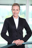 Executive Woman behind railings — Stock Photo
