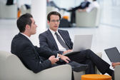 Businessmen sat in a waiting area — Stock Photo