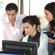 Office staff working at a computer — Stock Photo