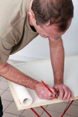 Man writing on a paper — Stock Photo