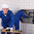 Stock Photo: Laborers working on piping