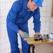 Stock Photo: Plumber marking pipes