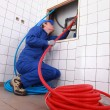 Stock Photo: Plumber installing piping