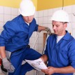 Electricians working together - Stockfoto