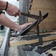 Stock Photo: Mpreparing slate for roof