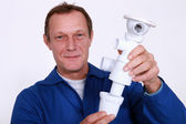 Man screwing siphon — Stock Photo