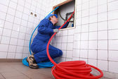 Plumber installing piping — Stock Photo