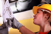 Female electrician with a wiring plan — Stock Photo