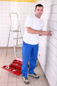 Electrician installing a wall socket — Stock Photo