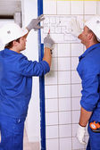 Electricians looking at a diagram — Stock Photo