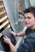 Young man with bitumen roof tiles — Stock Photo