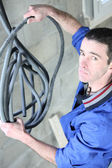 Electrician wiring a house — Stock Photo