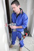 Electrician installing electrical outlet — Stock Photo