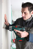 Man drilling into a wall — Stock Photo