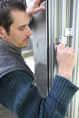 Handyman fitting new windows — Stock Photo