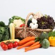 Basket of vegetables on white background — Stock Photo