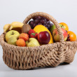 Stock Photo: Wicker basket full of fresh fruit at slight angle