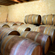 Wine barrels lined up in a cellar - Stockfoto