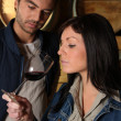 Stock Photo: Couple tasting wine in cellar Dubroca_Joffrey_140410;Bounie_Audrey_140410
