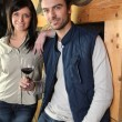 Couple standing in a wine cellar Dubroca_Joffrey_140410;Bounie_Audrey_140410 — Stock Photo
