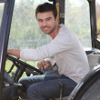 Stock Photo: Man about to drive tractor Dubroca_Joffrey_140410