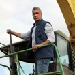 Farmer driving large vehicle — Stock Photo #18478363