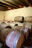 Wine barrels lined up in a cellar — Stock Photo