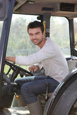 Man about to drive tractor Dubroca_Joffrey_140410 — Stock Photo