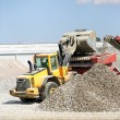 Stock Photo: Digger loading gravel into container