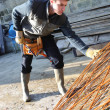 Construction worker with iron grids - Foto Stock