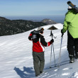 Two skiers walking in snow — Stock Photo #18481927
