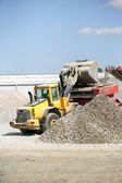 Digger loading gravel into a container — Stock Photo
