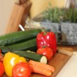 Stock Photo: Vegetables on a chopping board