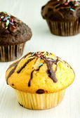 Delicious muffins on kitchen table — Stock Photo