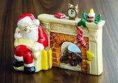 Santa Claus by the fireplace — Stock Photo