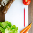 Cooking recipe on kitchen table — Stock Photo #15919733