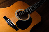 Acoustic guitar - close up — Stock Photo
