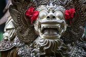 Balinese statue with hibiscus flower — Stock Photo