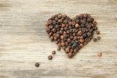 Heart shaped black pepper — Stock Photo