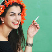 Young woman with cigarettes — Stock Photo