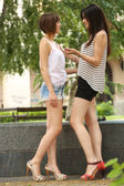 Two teenagers  talking on the street — Stock Photo