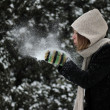 Winter woman blowing a snow — Stock Photo #8882639