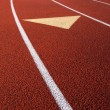 Stock Photo: Lanes of running track